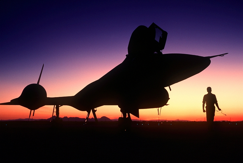 24. A U.S. Air Force SR-71 Blackbird Strategic Reconnaissance Training Aircraft Silhouetted At Sundown While Parked On the Runway, June 1, 1988, Beale Air Force Base, State of California, USA. Photo Credit: Tech. Sgt. Michael Haggerty, United States Air Force; Defense Visual Information (DVI, http://www.DefenseImagery.mil, DF-ST-89-06278) and United States Air Force (USAF, http://www.af.mil), United States Department of Defense (DoD, http://www.DefenseLink.mil or http://www.dod.gov), Government of the United States of America (USA).
