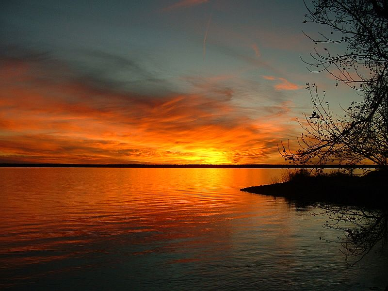 A Colorful and Gorgeous Sunset Over and Reflected On Lake Marion, Santee National Wildlife Refuge, State of South Carolina, USA. Photo Credit: Ginger L. Corbin, Southeast Image Library, United States Fish and Wildlife Service Digital Library System (http://images.fws.gov, personal slide), United States Fish and Wildlife Service (FWS, http://www.fws.gov), United States Department of the Interior (http://www.doi.gov), Government of the United States of America (USA).