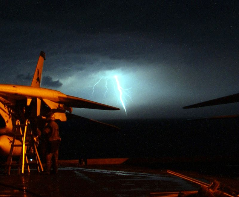 Bright, Hot, Vivid, and Intense Lightning Strike In the Distance, November 13, 2005, United States Navy USS Theodore Roosevelt (CVN 71), Persian Gulf. Photo Credit: Photographer's Mate Airman Javier Capella, Navy NewsStand - Eye on the Fleet Photo Gallery (http://www.news.navy.mil/view_photos.asp, 051113-N-0685C-001), United States Navy (USN, http://www.navy.mil), United States Department of Defense (DoD, http://www.DefenseLink.mil or http://www.dod.gov), Government of the United States of America (USA).