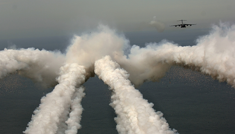3. A United States Air Force C-17 Globemaster III Military Transport with the 14th Airlift Squadron located at Charleston Air Force Base in South Carolina leaves a smoke trail after firing flares over the Atlantic Ocean during a local exercise. May 16, 2006, Over the Atlantic Ocean Near Charleston, State of South Carolina, USA. Photo Credit: TSgt. Russell E. Cooley IV, United States Air Force (USAF, http://www.af.mil); Defense Visual Information Center (DVIC, http://www.DoDMedia.osd.mil, 060516-F-9712C-446) and United States Air Force (USAF, http://www.af.mil), United States Department of Defense (DoD, http://www.DefenseLink.mil or http://www.dod.gov), Government of the United States of America (USA).. C-17 Globemaster III fact sheets from the United States Air Force <http://www.af.mil/factsheets/factsheet.asp?fsID=86> and The Boeing Company <http://www.boeing.com/defense-space/military/c17/index.htm>.
