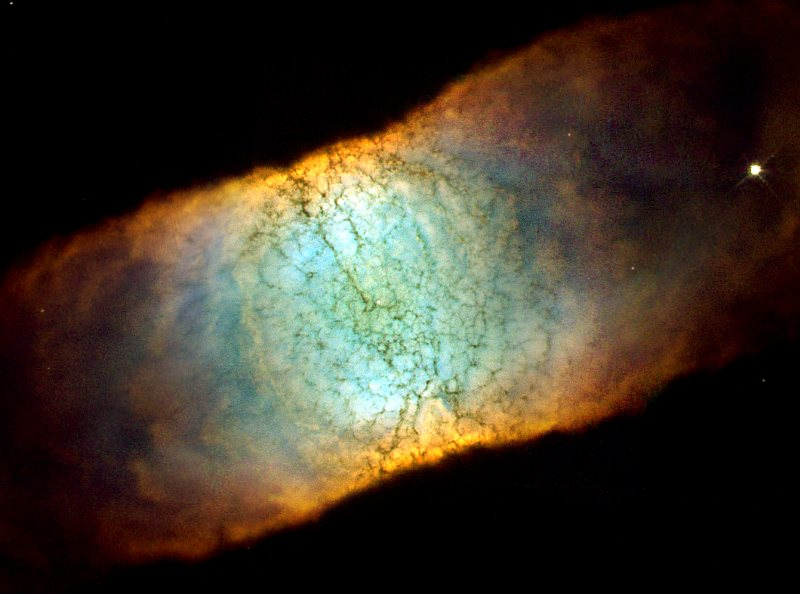 Side View of the Beautiful, and Highly Symmetrical, Bipolar Planetary Nebula IC 4406, Also Known as 'The Retina Nebula', Located in the Constellation Lupus. Photo Credit: The Retina Nebula: Dying Star IC 4406, June 28, 2001 and January 19, 2002 (Release date: June 13, 2002), STScI-2002-14, NASA's Earth-orbiting Hubble Space Telescope (http://HubbleSite.org); The Hubble Heritage Team (STScI/AURA), National Aeronautics and Space Administration (NASA, http://www.nasa.gov), Government of the United States of America (USA). Acknowledgment: C.R. O'Dell (Vanderbilt University).
