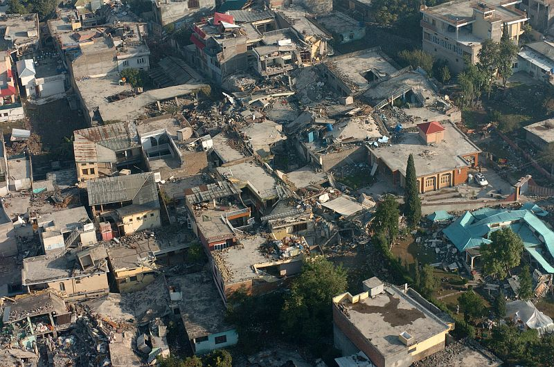 A sobering aerial view of the extensive devastation and destruction in the city of Muzafarabad caused by the October 8th, 2005 earthquake that shook the region. October 13, 2005, Muzafarabad, Islamic Republic of Pakistan. Photo Credit: Photographer's Mate 2nd Class Timothy Smith, Navy NewsStand - Eye on the Fleet Photo Gallery (http://www.news.navy.mil/view_photos.asp, 051013-N-8796S-110), United States Navy (USN, http://www.navy.mil), United States Department of Defense (DoD, http://www.DefenseLink.mil or http://www.dod.gov), Government of the United States of America (USA).