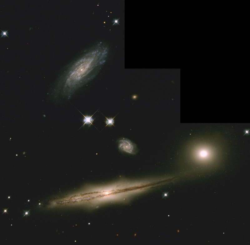 The Four Galaxies of the Hickson Compact Group 87 (HCG 87), a Cluster of Interacting Galaxies, Constellation Capricornus (Capricorn). Photo Credit: Hickson Compact Group 87: A Minuet of Four Galaxies, July 19-25, 1999 (Release date: September 2, 1999), STScI-1999-31, NASA's Earth-orbiting Hubble Space Telescope (http://HubbleSite.org); The Hubble Heritage Team (STScI/AURA), National Aeronautics and Space Administration (NASA, http://www.nasa.gov), Government of the United States of America (USA).