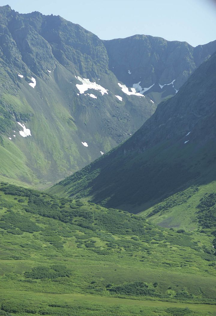 Foliage-Covered Valleys and Slopes in Shades of Green, Patches of White Snow Here and There, Mountain Peaks Reaching Boldly Into the Blue Sky -- This Grand View of the Mountains in Togiak National Wildlife Refuge (Togiak NWR 037) Is a Portrait of Power, Beauty, Strength and Majesty, State of Alaska, USA. Photo Credit: Steve Hillebrand, Alaska Image Library, United States Fish and Wildlife Service Digital Library System (http://images.fws.gov, DI-W5B0037TO), United States Fish and Wildlife Service (FWS, http://www.fws.gov), United States Department of the Interior (http://www.doi.gov), Government of the United States of America (USA).