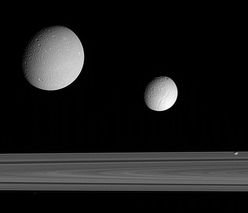 Splendid View of Three Saturnian Moons Near Planet Saturn's Broad and Majestic Rings: Dione (Top Left), Tethys (Center), and F-Ring Shepherd Moon Pandora (Lower Right). Photo Credit: Satellite Trio, Cassini-Huygens Mission (http://saturn.jpl.nasa.gov), Cassini Orbiter, September 2005; Planetary Photojournal (http://photojournal.jpl.nasa.gov, PIA07628), National Aeronautics and Space Administration (NASA, http://www.nasa.gov)/Jet Propulsion Laboratory (JPL, http://www.jpl.nasa.gov), Government of the United States of America.