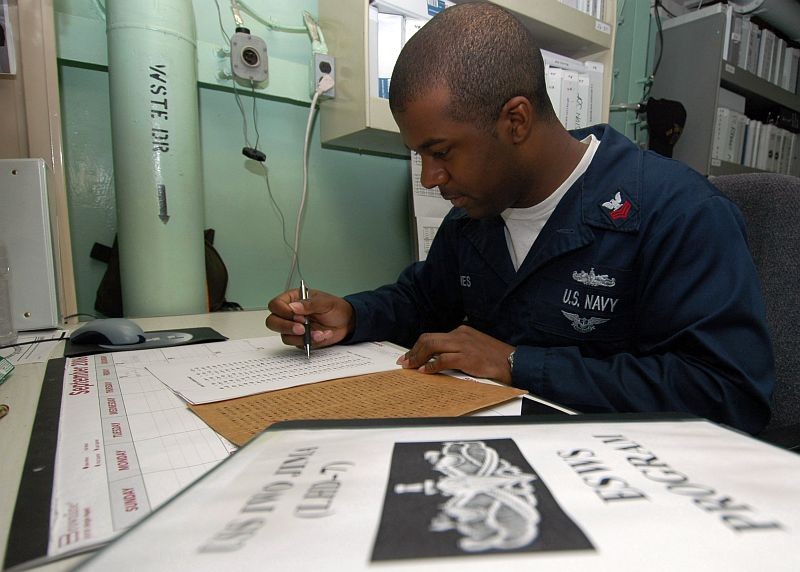 Grading a Sailor's Test Aboard the United States Navy Amphibious Assault Ship USS Iwo Jima (LHD 7), September 2, 2006 in the Arabian Sea. Photo Credit: Mass Communication Specialist Seaman Joshua T. Rodriguez, Navy NewsStand - Eye on the Fleet Photo Gallery (http://www.news.navy.mil/view_photos.asp, 060902-N-6403R-005), United States Navy (USN, http://www.navy.mil), United States Department of Defense (DoD, http://www.DefenseLink.mil or http://www.dod.gov), Government of the United States of America (USA).