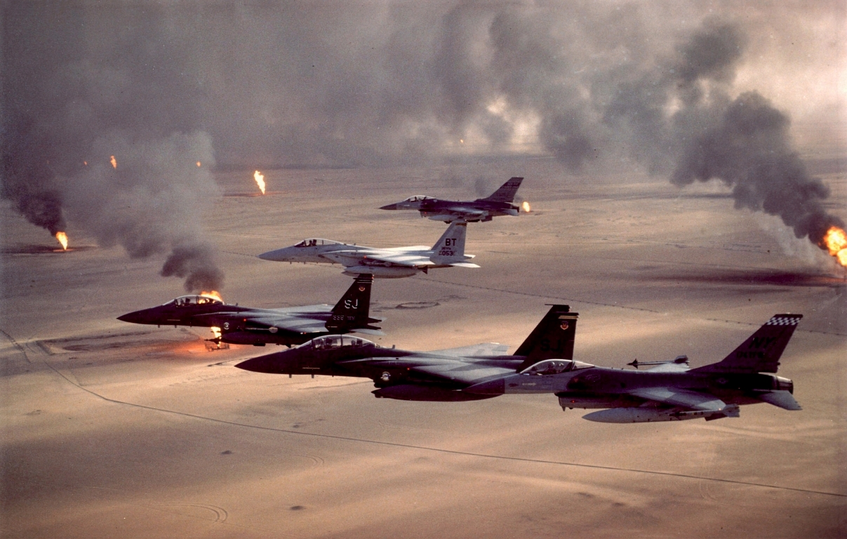 4. F-15E Strike Eagle, F-15C Eagle, and F-16A Fighting Falcon Fighter Jets Fly In Formation Over Burning Oil Wells During Operation Desert Storm, 1991, Dawlat al Kuwayt - State of Kuwait. Photo Credit: Tech. Sgt. Fernando Serna, Air Force Link - Photos (http://www.af.mil/photos, 071009-F-2911S-013, 'Operation Desert Storm'), United States Air Force (USAF, http://www.af.mil), United States Department of Defense (DoD, http://www.DefenseLink.mil or http://www.dod.gov), Government of the United States of America (USA).