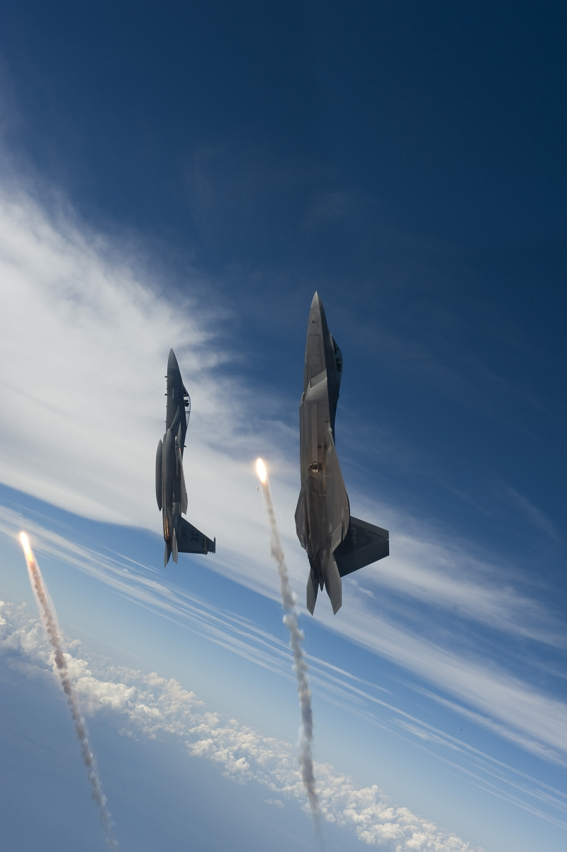 8. Going Vertical, One U.S. Air Force F-22A Raptor Stealth Fighter Jet and One U.S. Air Force F-15 Eagle Fighter Jet Each Fire One Flare While Over the Gulf of Mexico, August 27, 2008, New Orleans Naval Air Station, State of Louisiana, USA. Photo Credit: Staff Sgt. James L. Harper Jr., United States Air Force; Defense Visual Information (DVI, http://www.DefenseImagery.mil, 080827-F-4177H-103 and 080827-F-OK231-103) and United States Air Force (USAF, http://www.af.mil), United States Department of Defense (DoD, http://www.DefenseLink.mil or http://www.dod.gov), Government of the United States of America (USA).