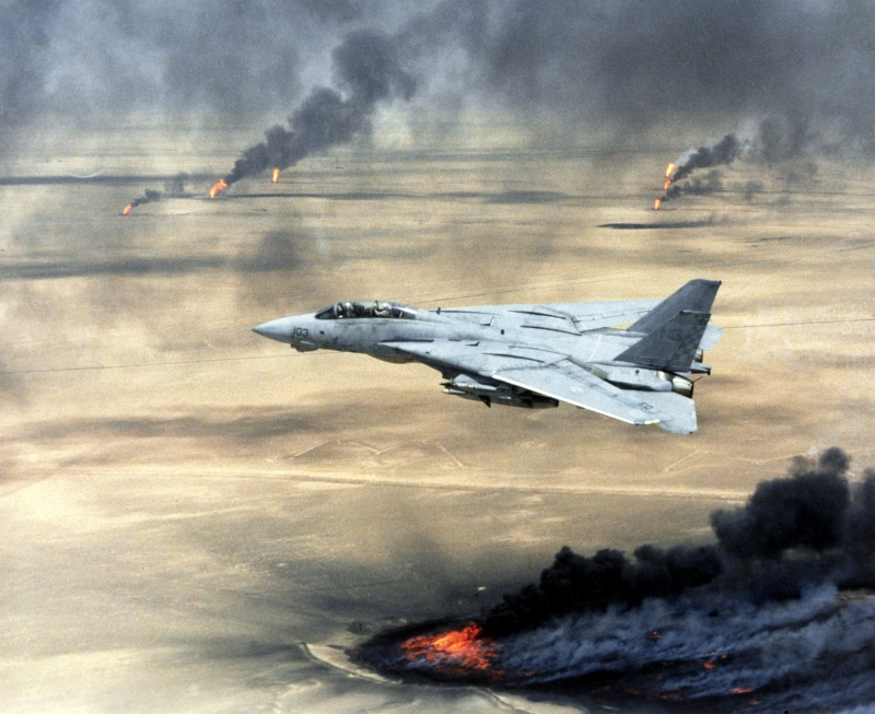 7. A U.S. Navy F-14A Tomcat Fighter Jet Flies Over Burning Oil Wells During Operation Desert Storm, February 1, 1991, Dawlat al Kuwayt - State of Kuwait. Photo Credit: Defense Visual Information (DVI, http://www.DefenseImagery.mil, DN-SC-04-15221) and United States Navy (USN, http://www.navy.mil), United States Department of Defense (DoD, http://www.DefenseLink.mil or http://www.dod.gov), Government of the United States of America (USA).