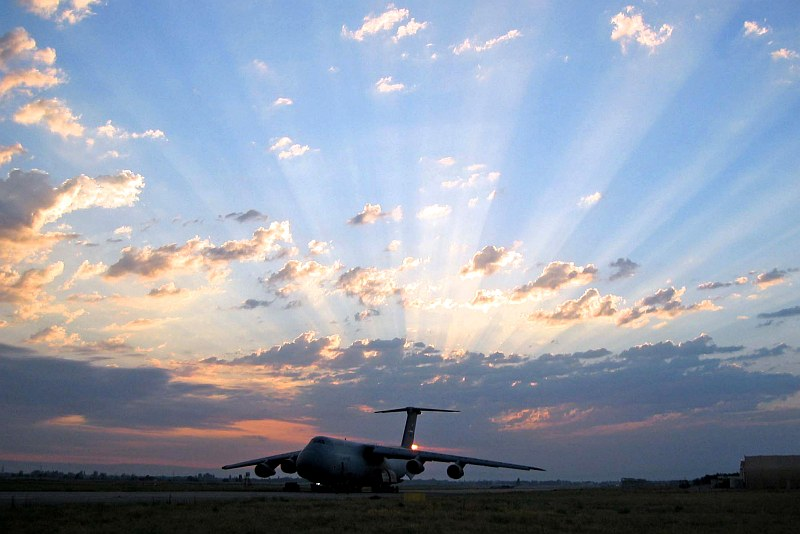 """A Beautiful Sunset. The Huge C-5 Galaxy Oversize Cargo Transport Is With United States Air Force Reserve Command 433rd Airlift Wing. Photo Credit: Captain Jeremy Angel, United States Air Force; Air Force Link - Week in Photos, March 10, 2006 (http://www.af.mil/weekinphotos/060310-10.html and http://www.af.mil/weekinphotos/wipgallery.asp?week=158, 060309-F-7692M-111, """"C-5 at Sunset""""), United States Air Force (USAF, http://www.af.mil), United States Department of Defense (DoD, http://www.DefenseLink.mil or http://www.dod.gov), Government of the United States of America (USA)."""