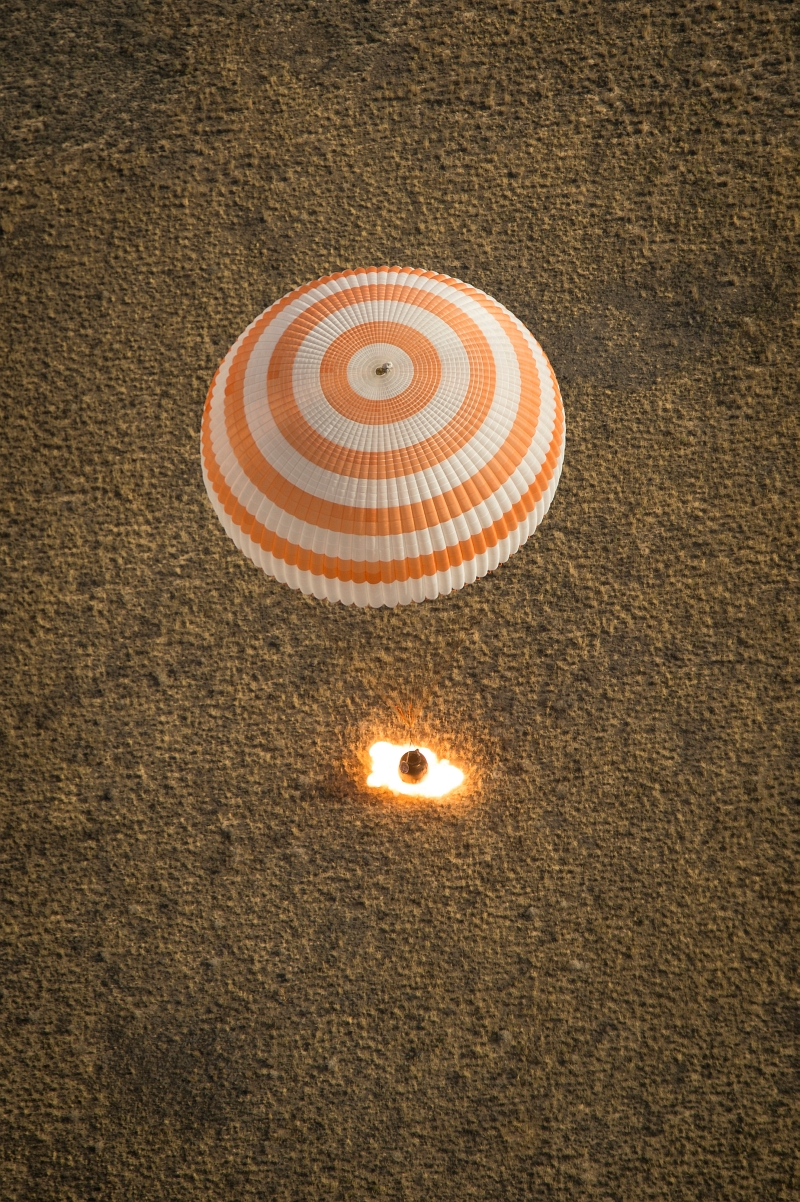 42. Parachute Fully Deployed and Retrograde Rockets (Retro-Rockets) Ignited, Russian Federation's Soyuz TMA-08M Spacecraft Lands In A Remote Area Near the Town of Zhezkazgan, September 11, 2013, Qazaqstan Respublikasy - Republic of Kazakhstan. Photo Credit: Bill Ingalls, NASA; 201309110001hq, 'Expedition 36 Soyuz Landing' (http://www.nasa.gov/content/expedition-36-soyuz-landing/), National Aeronautics and Space Administration (NASA, http://www.nasa.gov), Government of the United States of America.