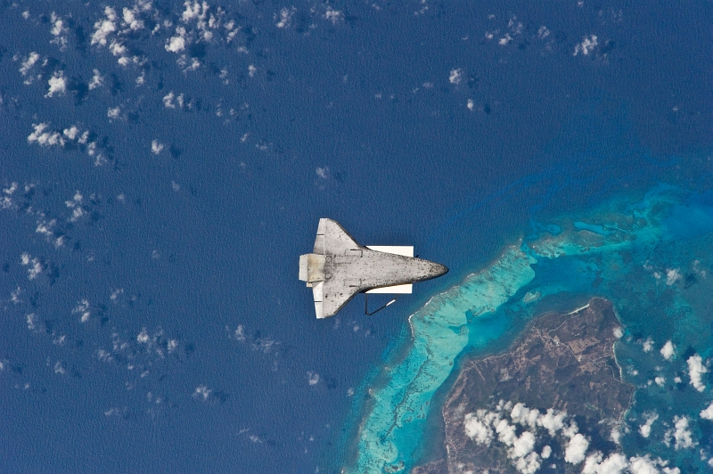 3. The Underside (Belly) of Space Shuttle Discovery (STS-131), April 17, 2010, As Seen From the International Space Station (Expedition Twenty-Three) While Orbiting Above the Caribbean Sea and Near Colombia's Isla de Providencia. Photo Credit: STS-131 Shuttle Mission Imagery (http://spaceflight.nasa.gov/gallery/images/shuttle/sts-131/ndxpage1.html), ISS023-E-025405 (http://spaceflight.nasa.gov/gallery/images/shuttle/sts-131/html/iss023e025405.html), NASA Human Space Flight (http://spaceflight.nasa.gov), National Aeronautics and Space Administration (NASA, http://www.nasa.gov), Government of the United States of America. Additional details from NASA: 'The recognizable feature on Earth below is the south end of Isla de Providencia, about 150 miles off the coast of Nicaragua near 13.3 degrees north latitude 81.4 degrees west longitude. The island belongs to Colombia.'