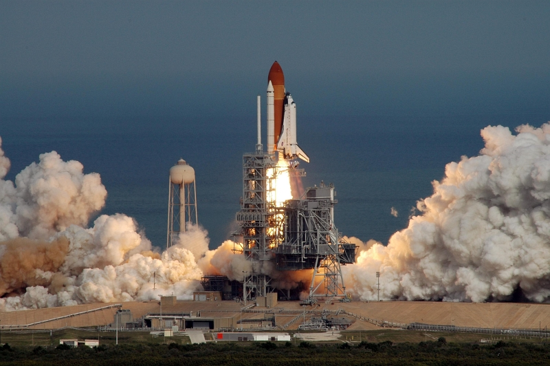 40. Backdropped By the Atlantic Ocean, Space Shuttle Atlantis (STS-122) Lifts Off From Launch Pad 39A, February 7, 2008, NASA Kennedy Space Center, State of Florida, USA. Photo Credit: Jim Grossmann; Kennedy Media Gallery (http://mediaarchive.ksc.nasa.gov) Photo Number: KSC-08PD-0202, John F. Kennedy Space Center (KSC, http://www.nasa.gov/centers/kennedy), National Aeronautics and Space Administration (NASA, http://www.nasa.gov), Government of the United States of America.