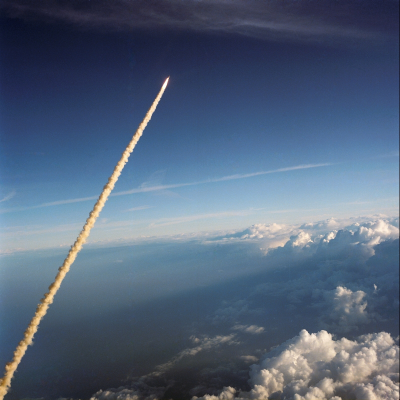 19. Space Shuttle Challenger (STS-41B) Rising High Above Cloudy Earth, February 3, 1984. Photo Credit: National Aeronautics and Space Administration (NASA, http://www.nasa.gov), Government of the United States of America (USA).