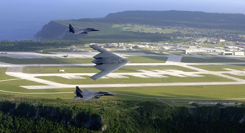 30. Two U.S. Air Force F-15E Strike Eagle Fighter Jets and One U.S. Air Force B-2 Spirit Stealth Bomber Fly In Formation Over Andersen Air Force Base, July 5, 2005, Territory of Guam, USA. Photo Credit: Tech. Sgt. Cecilio M. Ricardo, United States Air Force; Defense Visual Information (DVI, http://www.DefenseImagery.mil, 050705-F-MJ260-001 or DF-SD-08-19937) and United States Air Force (USAF, http://www.af.mil), United States Department of Defense (DoD, http://www.DefenseLink.mil or http://www.dod.gov), Government of the United States of America (USA).