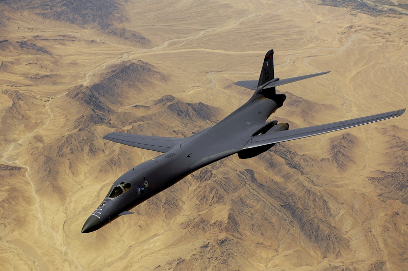 31. A U.S. Air Force B-1B Lancer Long-Range, Supersonic, Heavy Bomber Over the Mountains, May 27, 2008, Jomhuri-ye Eslami-ye Afghanestan - Islamic Republic of Afghanistan. Photo Credit: Master Sgt. Andy Dunaway, United States Air Force; Defense Visual Information (DVI, http://www.DefenseImagery.mil, 080527-F-BC606-071 or 080527-F-2828D-071) and United States Air Force (USAF, http://www.af.mil), United States Department of Defense (DoD, http://www.DefenseLink.mil or http://www.dod.gov), Government of the United States of America (USA).