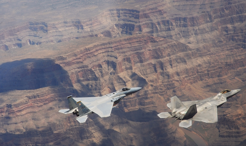 11. A U.S. Air Force F-22A Raptor Stealth Fighter and a U.S. Air Force F-15C Eagle Fighter Jet Fly Over the Grand Canyon, July 16, 2010, Grand Canyon National Park, State of Arizona, USA. Photo Credit: Master Sgt. Kevin J. Gruenwald, United States Air Force; AF.mil - Photos (http://www.af.mil/photos, 100716-F-6911G-180), United States Department of Defense (DoD, http://www.DefenseLink.mil or http://www.dod.gov), Government of the United States of America (USA).