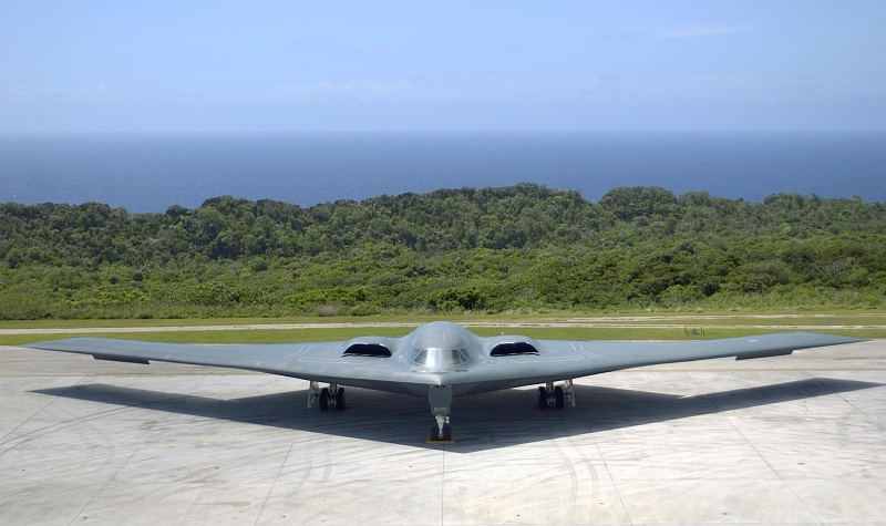 23. Backdropped By the Pacific Ocean, A U.S. Air Force B-2 Spirit Stealth Bomber Sits On the Ramp at Andersen Air Force Base, March 24, 2005. Photo Credit: Staff Sgt. Bennie J. Davis III, United States Air Force; Defense Visual Information (DVI, http://www.DefenseImagery.mil, DF-SD-08-16977, 050324-F-5040D-013, and 050324-F-VY627-013) and United States Air Force (USAF, http://www.af.mil), United States Department of Defense (DoD, http://www.DefenseLink.mil or http://www.dod.gov), Government of the United States of America (USA).