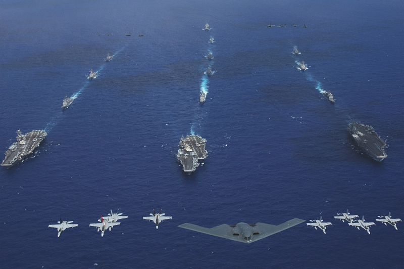 24. Exercise Valiant Shield 2006: A U.S. Air Force (USAF) B-2 Spirit Stealth Bomber, USAF F-16 Fighting Falcons, USAF F-15 Eagles, Along With U.S. Navy (USN) and U.S. Marine Corps (USMC) F/A-18 Hornets and Super Hornets  Fly Over the USS Abraham Lincoln (CVN 72), USS Kitty Hawk (CV 63), and USS Ronald Reagan (CVN 76) Carrier Strike Groups, June 18, 2006, Philippine Sea, Territory of Guam, USA. Photo Credit: Chief Photographer's Mate Todd P. Cichonowicz, United States Navy (USN, http://www.navy.mil); Defense Visual Information (DVI, http://www.DoDMedia.osd.mil, 060618-N-8492C-212) and United States Navy (USN, http://www.navy.mil), United States Department of Defense (DoD, http://www.DefenseLink.mil or http://www.dod.gov), Government of the United States of America (USA).