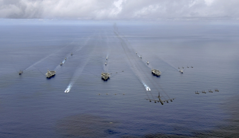 32. Exercise Valiant Shield 2007: A USAF B-52 Stratofortress Heavy Bomber Leads A Formation of U.S. Fighter Jets As They Fly Over the USS Nimitz (CVN 68), USS Kitty Hawk (CV 63), and USS John C. Stennis (CVN 74) Carrier Strike Groups, August 14, 2007, Pacific Ocean, Territory of Guam, USA. Photo Credit: Mass Communication Specialist 1st Class Hana'lei Shimana, Navy News Service - Eye on the Fleet (http://www.news.navy.mil/view_photos.asp, 070814-N-6009S-001), United States Navy (USN, http://www.navy.mil), United States Department of Defense (DoD, http://www.DefenseLink.mil or http://www.dod.gov), Government of the United States of America (USA).