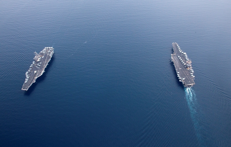36. United States Navy Aircraft Carriers In the Strait of Bab el-Mandeb (Bab el Mandeb): The USS Enterprise (CVN 65), On the Right, Passes the USS George H.W. Bush (CVN 77), On the Left, June 21, 2011, Red Sea. Photo Credit: Mass Communication Specialist 2nd Class Brooks B. Patton Jr., United States Navy; Defense Visual Information (DVI, http://www.DefenseImagery.mil, 110621-N-JL826-001) and United States Navy (USN, http://www.navy.mil), United States Department of Defense (DoD, http://www.DefenseLink.mil or http://www.dod.gov), Government of the United States of America (USA).