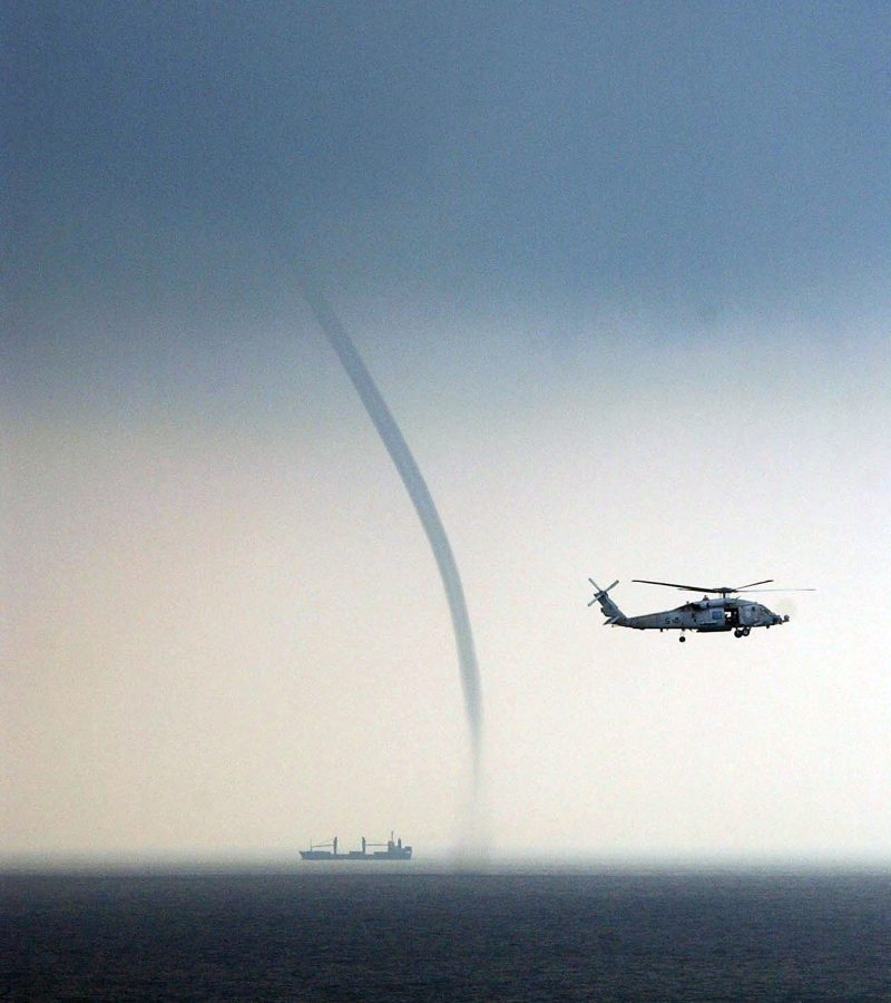 Tornado Over Water -- a Waterspout -- In the South China Sea, September 5, 2004, Off the Coast of Malaysia. Photo Credit: Photographer's Mate Airman Richard R. Waite, Navy NewsStand - Eye on the Fleet Photo Gallery (http://www.news.navy.mil/view_photos.asp, 040905-N-1513W-085), United States Navy (USN, http://www.navy.mil), United States Department of Defense (DoD, http://www.DefenseLink.mil or http://www.dod.gov), Government of the United States of America (USA).