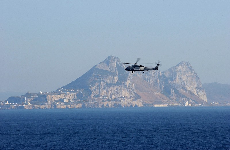 The Rock of Gibraltar, Located on Gibraltar, as Seen From the Strait of Gibraltar (Straits of Gibraltar), July 10, 2004. Gibraltar, Overseas Territory of the United Kingdom of Great Britain and Northern Ireland. Photo Credit: Photographer's Mate Airman Lilliana LaVende, Navy NewsStand - Eye on the Fleet Photo Gallery (http://www.news.navy.mil/view_photos.asp, 040710-N-2805L-034), United States Navy (USN, http://www.navy.mil), United States Department of Defense (DoD, http://www.DefenseLink.mil or http://www.dod.gov), Government of the United States of America (USA).