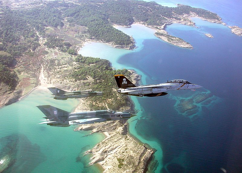 """Beautiful Aerial View of Croatia and the Adriatic Sea, November 1, 2002, Republika Hrvatska - Republic of Croatia. Also Visible Are a United States Navy F-14 Tomcat Jet Fighter, Assigned to the """"Jolly Rogers"""" of Fighter Squadron One Zero Three (VF-103), Flying in Formation With Two Zrakoplovstvo Nezavisna Drzava Hrvatska (Zrakoplovstvo NDH) -- Croatian Air Force -- MiG-21 """"Fishbed"""" Fighter Jets During the """"Joint Wings 2002"""" Exercise.Photo Credit: Capt. Dana Potts, Navy NewsStand - Eye on the Fleet Photo Gallery (http://www.news.navy.mil/view_photos.asp, 021101-N-1955P-001), United States Navy (USN, http://www.navy.mil), United States Department of Defense (DoD, http://www.DefenseLink.mil or http://www.dod.gov), Government of the United States of America (USA)."""