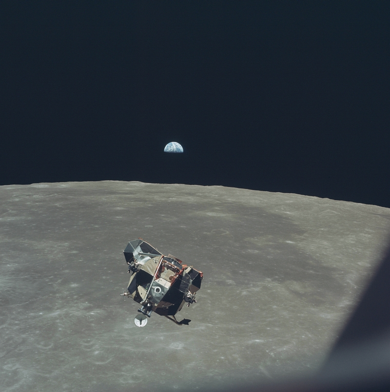 26. Beautiful, Half-Illuminated, White-and-Blue Earth Backdrops the Liftoff of the NASA Apollo 11 Lunar Module ('Eagle') From the Moon's Surface, July 21, 1969 (19690721), As Seen From the Orbiting NASA Apollo 11 Command and Service Modules ('Columbia'). Photo Credit: NASA Astronaut Michael Collins; AS11-44-6642, Earth, Moon surface, Apollo 11 Lunar Module 'Eagle' ascent stage, Orbiting Apollo 11 Command and Service Modules (CSM) 'Columbia', Apollo XI Mission; Image Science and Analysis Laboratory, NASA-Johnson Space Center. 'Astronaut Photography of Earth - Display Record.' <http://eol.jsc.nasa.gov/scripts/sseop/photo.pl?mission=AS11&roll=44&frame=6642>; National Aeronautics and Space Administration (NASA, http://www.nasa.gov), Government of the United States of America (USA).