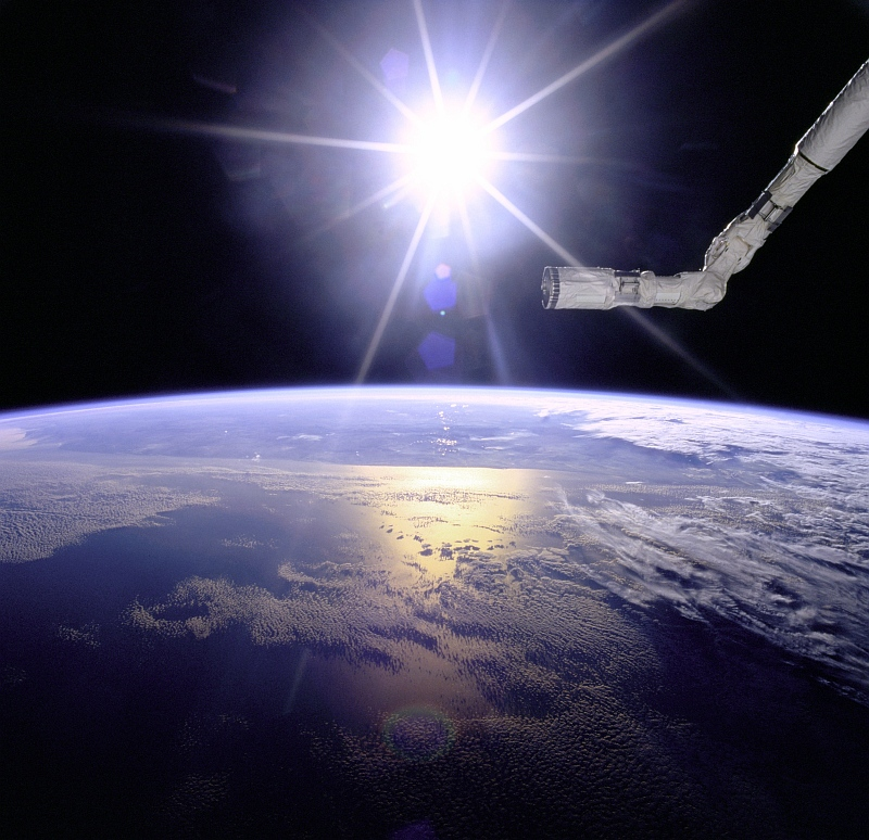 23. Brilliant Sunburst Over Earth, May 1996, As Seen From Space Shuttle Endeavour (STS-77). Photo Credit: NASA; Earth's atmospheric limb, Space Shuttle Endeavour (STS-66) Remote Manipulator System (RMS) Canada Arm (Robot Arm), Sunburst over Earth, GRIN (http://grin.hq.nasa.gov) Database Number: GPN-2000-001097, National Aeronautics and Space Administration (NASA, http://www.nasa.gov), Government of the United States of America.