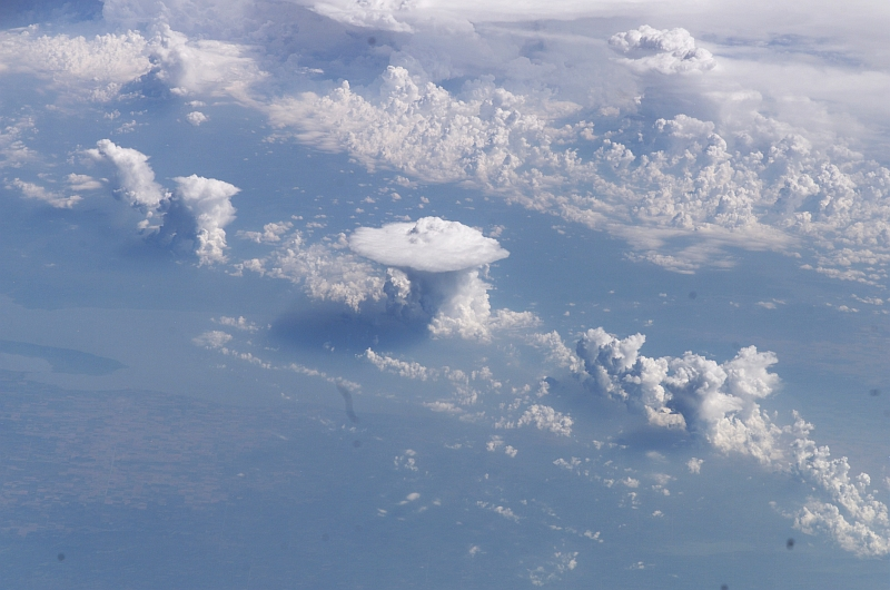 31. Cumulonimbus Clouds and Anvils Over Canada, North America, August 19, 2003 at 18:13:39.563 GMT As Seen From the International Space Station (Expedition 7), Latitude (LAT): 49.6, Longitude (LON): -113.1, Altitude (ALT): 202 Nautical Miles, Sun Azimuth (AZI): 148 degrees, Sun Elevation Angle (ELEV): 50 degrees. Photo Credit: NASA; ISS007-E-13020, Cumulonimbus Clouds and Anvils, Canada, United States of America, North America, International Space Station (Expedition Seven); Image Science and Analysis Laboratory, NASA-Johnson Space Center. 'Astronaut Photography of Earth - Display Record.' <http://eol.jsc.nasa.gov/scripts/sseop/photo.pl?mission=ISS007&roll=E&frame=13020>; National Aeronautics and Space Administration (NASA, http://www.nasa.gov), Government of the United States of America (USA).