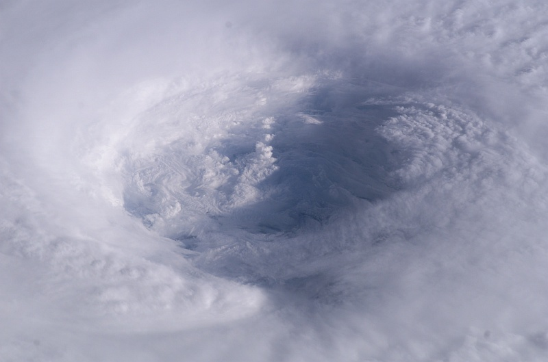 6. A Detailed Look Inside Hurricane Isabel's Cloudy Eye, Over the Atlantic Ocean on September 13, 2003 at 11:18:44.230 GMT, As Seen From the International Space Station (Expedition 7). Photo Credit: NASA Astronaut Dr. Edward Tsang Lu, Ph.D. aboard the International Space Station (Expedition Seven); ISS007-E-14745, Detailed view of Hurricane Isabel's eye, Eyewall structure, Atlantic Ocean; Image Science and Analysis Laboratory, NASA-Johnson Space Center. 'Astronaut Photography of Earth - Display Record.' <http://eol.jsc.nasa.gov/scripts/sseop/photo.pl?mission=ISS007&roll=E&frame=14745>; National Aeronautics and Space Administration (NASA, http://www.nasa.gov), Government of the United States of America (USA).