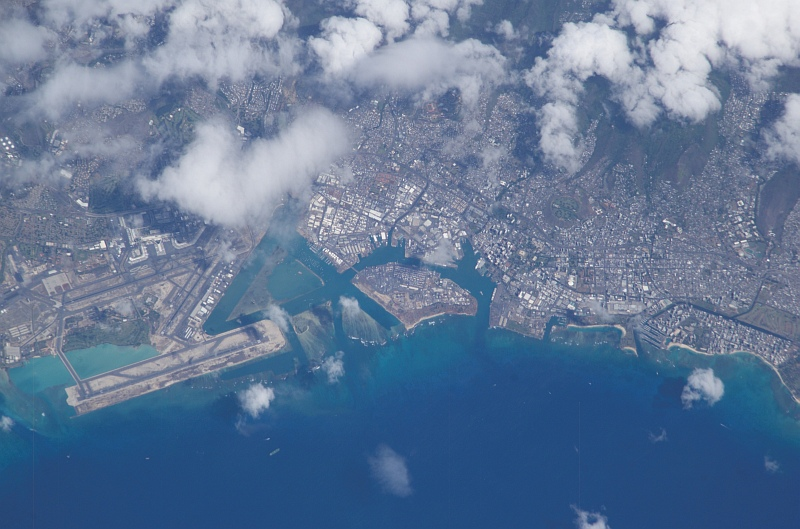 24. Clouds Over Oaho, State of Hawaii, USA, October 8, 2003, As Seen From the International Space Station (Expedition 7). Photo Credit: NASA; ISS007-E-16807, Oahu, Hawaii, Honolulu International Airport, Keehi Lagoon, Sand Island, Pacific Ocean, International Space Station (Expedition Seven); Image Science and Analysis Laboratory, NASA-Johnson Space Center. 'Astronaut Photography of Earth - Display Record.' <http://eol.jsc.nasa.gov/scripts/sseop/photo.pl?mission=ISS007&roll=E&frame=16807>; National Aeronautics and Space Administration (NASA, http://www.nasa.gov), Government of the United States of America (USA).