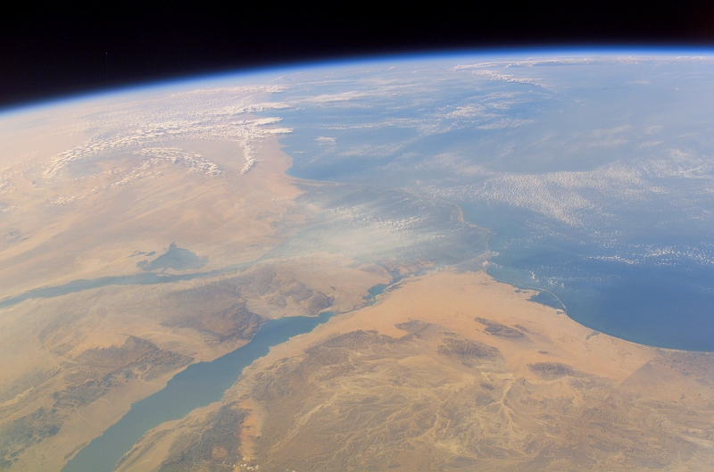 17. Clouds Over North Africa and the Mediterranean Sea and a Scenic View of the Nile River, the Nile River Delta, Gulf of Suez and Part of the Sinai Peninsula in Jumhuriyat Misr al-Arabiyah - Arab Republic of Egypt on October 11, 2007 at 12:42:24.672 GMT As Seen From the International Space Station (Expedition 15); Latitude (LAT): 29.0, Longitude (LON): 39.4, Altitude (ALT): 182 Nautical Miles, Sun Azimuth (AZI): 244 degrees, Sun Elevation Angle (ELEV): 27 degrees. Photo Credit: NASA; ISS015-E-34872, Earth's limb, Clouds, North Africa, Mediterranean Sea, Nile River, Nile River Delta, Gulf of Suez, Sinai Peninsula, International Space Station (Expedition Fifteen); Image Science and Analysis Laboratory, NASA-Johnson Space Center. 'Astronaut Photography of Earth - Display Record.' <http://eol.jsc.nasa.gov/scripts/sseop/photo.pl?mission=ISS015&roll=E&frame=34872>; National Aeronautics and Space Administration (NASA, http://www.nasa.gov), Government of the United States of America (USA).