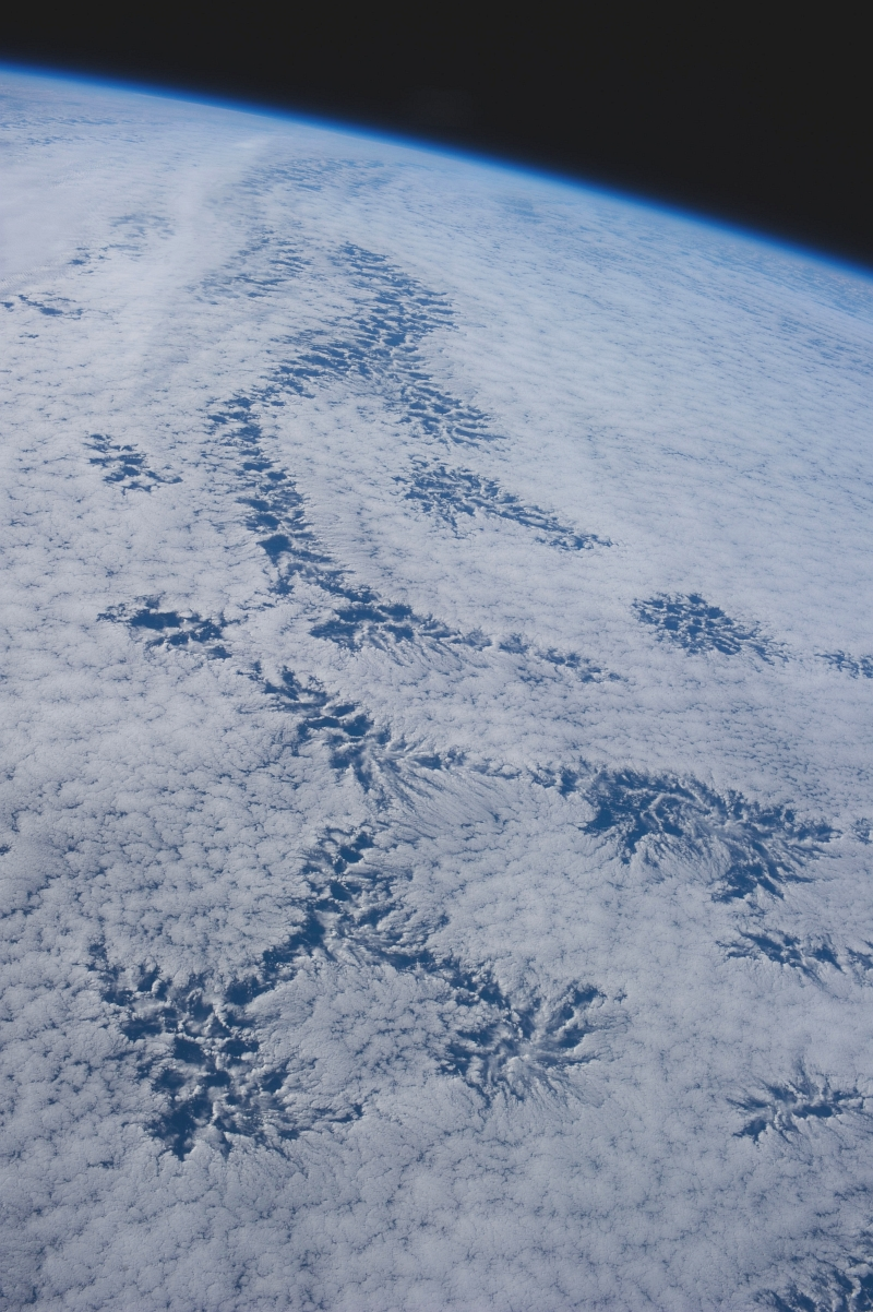 48b. Cloud Patterns, July 26, 2013 at 20:40:40 GMT, As Seen From the International Space Station (Expedition 36) While Orbiting Over the South Pacific Ocean, Latitude (LAT): -43.9, Longitude (LON): -113.9, Altitude (ALT): 226 Nautical Miles, Sun Azimuth (AZI): 345 degrees, Sun Elevation Angle (ELEV): 26 degrees. Photo Credit: NASA; ISS036-E-25842, International Space Station (Expedition 36); Image Science and Analysis Laboratory, NASA-Johnson Space Center. 'The Gateway to Astronaut Photography of Earth.' <http://eol.jsc.nasa.gov/scripts/sseop/photo.pl?mission=ISS036&roll=E&frame=25842>; National Aeronautics and Space Administration (NASA, http://www.nasa.gov), Government of the United States of America (USA).