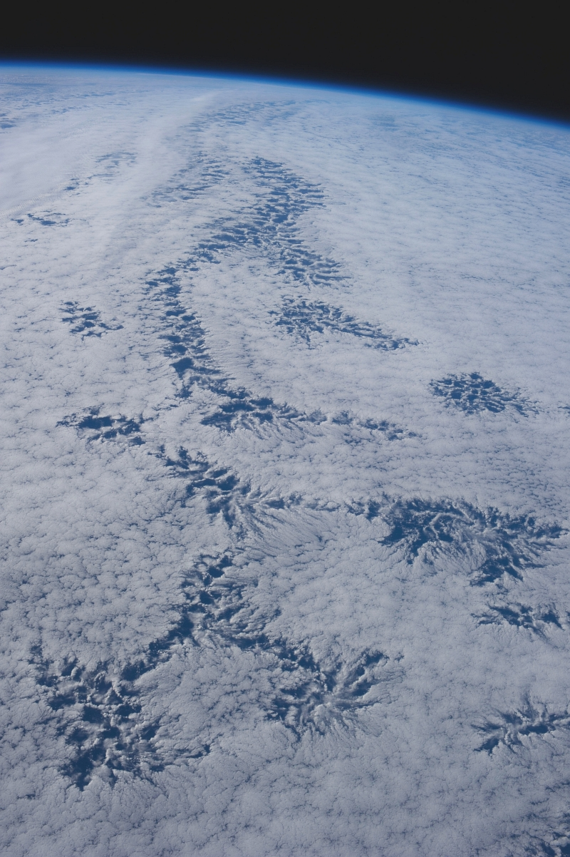 48. Cloud Patterns, July 26, 2013 at 20:40:51 GMT, As Seen From the International Space Station (Expedition 36) While Orbiting Over the South Pacific Ocean, Latitude (LAT): -44.3, Longitude (LON): -113.1, Altitude (ALT): 226 Nautical Miles, Sun Azimuth (AZI): 344 degrees, Sun Elevation Angle (ELEV): 25 degrees. Photo Credit: NASA; ISS036-E-25843, International Space Station (Expedition 36); Image Science and Analysis Laboratory, NASA-Johnson Space Center. 'The Gateway to Astronaut Photography of Earth.' <http://eol.jsc.nasa.gov/scripts/sseop/photo.pl?mission=ISS036&roll=E&frame=25843>; National Aeronautics and Space Administration (NASA, http://www.nasa.gov), Government of the United States of America (USA).