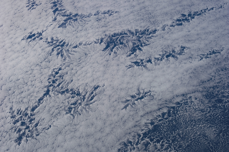 48d. Cloud Patterns, July 26, 2013 at 20:41:22 GMT, As Seen From the International Space Station (Expedition 36) While Orbiting Over the South Pacific Ocean, Latitude (LAT): -45.2, Longitude (LON): -110.8, Altitude (ALT): 226 Nautical Miles, Sun Azimuth (AZI): 342 degrees, Sun Elevation Angle (ELEV): 24 degrees. Photo Credit: NASA; ISS036-E-25844, International Space Station (Expedition 36); Image Science and Analysis Laboratory, NASA-Johnson Space Center. 'The Gateway to Astronaut Photography of Earth.' <http://eol.jsc.nasa.gov/scripts/sseop/photo.pl?mission=ISS036&roll=E&frame=25844>; National Aeronautics and Space Administration (NASA, http://www.nasa.gov), Government of the United States of America (USA).