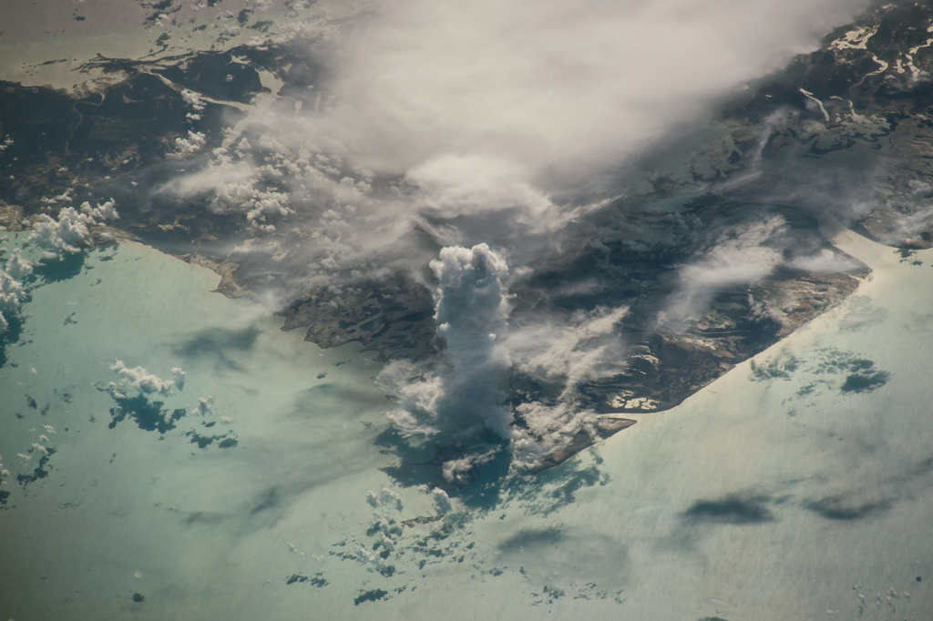 49. A Huge, Very Tall, Vertical, Pillar of A Cloud: One Cumulus Castellanus Over Andros Island, 19 July 2016 at 13:30:14 GMT, Commonwealth of The Bahamas, United Kingdom of Great Britain and Northern Ireland, As Seen From the International Space Station (Expedition 36) While Orbiting Over the Gulf of Mexico, International Space Station (ISS) Nadir Latitude: 23.4, ISS Nadir Longitude: -83.7, Altitude: 216 Nautical Miles, Sun Azimuth: 79 degrees, Sun Elevation Angle: 32 degrees, Photo Center Point Latitude: 24.7, Photo Center Point Longitude: -78.3, Nadir to Photo Center: East. Photo Credit: NASA; ISS048-E-38518, International Space Station (Expedition 48); Billy Island, Williams Island, Andros Island, castle cloud; Image courtesy of the Earth Science and Remote Sensing Unit, NASA Johnson Space Center, https://eol.jsc.nasa.gov. National Aeronautics and Space Administration (NASA, http://www.nasa.gov), Government of the United States of America (USA).