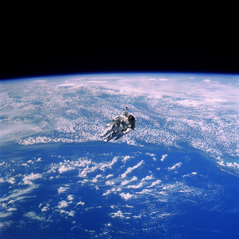 21. NASA Astronaut Robert L. Stewart Floats Above Cloudy Earth During an Untethered Extravehicular Activity (EVA), February 1984, As Seen From Space Shuttle Challenger (STS-41B). Photo Credit: National Aeronautics and Space Administration (NASA, http://www.nasa.gov, STS41B-35-1659, http://eol.jsc.nasa.gov/scripts/sseop/photo.pl?mission=STS41B&roll=35&frame=1659), Space Shuttle Challenger (STS-41-B); Defense Visual Information Center (DVIC, http://www.DoDMedia.osd.mil, DF-SC-84-10569) and United States Air Force (USAF, http://www.af.mil), United States Department of Defense (DoD, http://www.DefenseLink.mil or http://www.dod.gov), Government of the United States of America (USA).