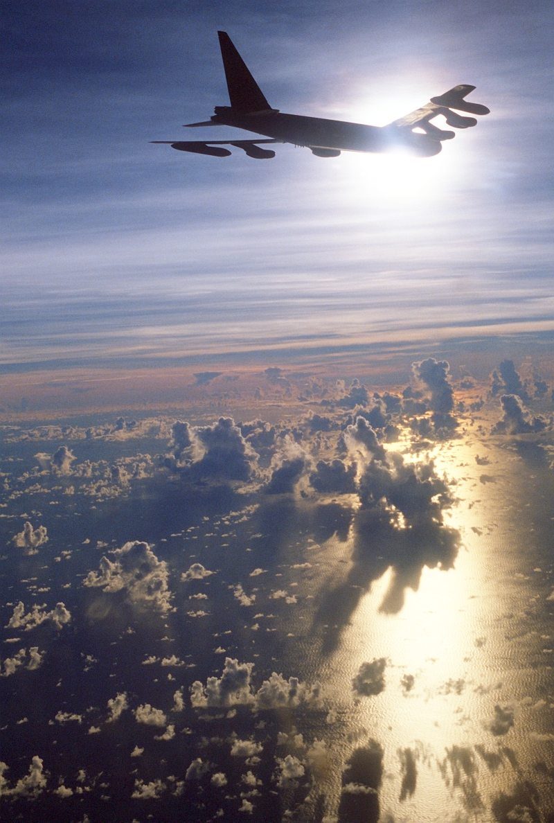 34. A United States Air Force B-52 Stratofotress Heavy Bomber Flies Over a Cloud-Covered Ocean, May 31, 1986. Photo Credit: Defense Visual Information Center (DVIC, http://www.DoDMedia.osd.mil and http://www.DefenseImagery.mil, DFST8612528) and United States Air Force (USAF, http://www.af.mil), United States Department of Defense (DoD, http://www.DefenseLink.mil or http://www.dod.gov), Government of the United States of America (USA).