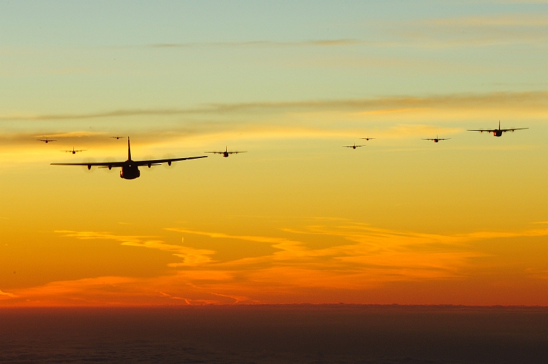 47. Exercise Bayonet Resolve: Early In the Morning, U.S. Air Force C-130J Super Hercules Aircraft From the 37th Airlift Squadron at Ramstein Air Base, Germany, Fly In A 10-Ship Formation Over Southern Germany, October 5, 2011, Bundesrepublik Deutschland - Federal Republic of Germany. Photo Credit: Senior Airman Stephen J. Otero, United States Air Force; Ramstein Air Base - Photos (http://www.ramstein.af.mil/photos, 111005-F-QF220-016, 'Dawn'), United States Air Force (USAF, http://www.af.mil), United States Department of Defense (DoD, http://www.DefenseLink.mil or http://www.dod.gov), Government of the United States of America (USA).