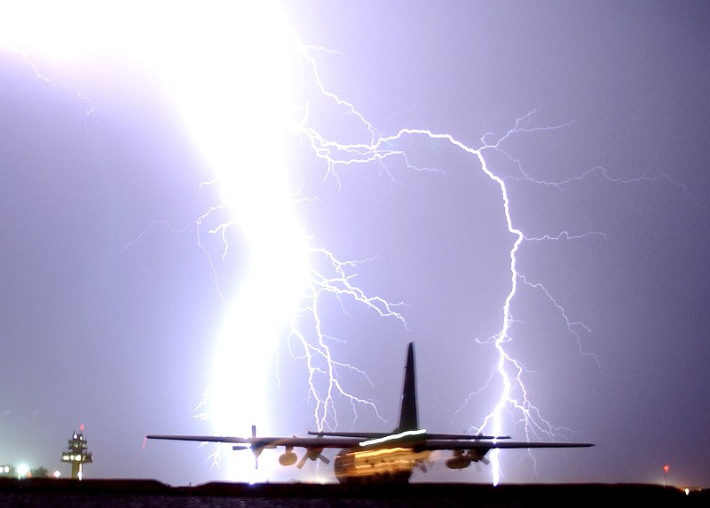 1. This Storm Generates a Very Powerful, Intense, Massive, Bright, Column-Shaped, and Hot Lightning Bolt That Strikes Near the Airport's Control Tower and a Taxiing C-130 Hercules Aircraft, May 16, 2006, Balad Air Base, Al Jumhuriyah al Iraqiyah - Republic of Iraq. Photo Credit: Senior Airman James Croxon, Air Force Link - Photos (http://www.af.mil/photos, 060516-F-0185C-001, Nature's firework), United States Air Force (USAF, http://www.af.mil), United States Department of Defense (DoD, http://www.DefenseLink.mil or http://www.dod.gov), Government of the United States of America (USA).