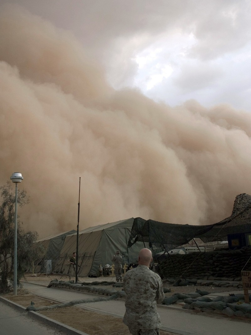 3. No Human Power Can Stop the Dry Desert Winds From Blowing In This Very Powerful, Relentless, Nightfall or Evening Windstorm Which Is Bringing Huge Clouds of Sand (and Dust) - a Massive Sandstorm - Rolling Over and Engulfing the Tents on the Base (Camp), April 27, 2005, Al Asad, Al Anbar Province, Al Jumhuriyah al Iraqiyah - Republic of Iraq. Photo Credit: Corporal Alicia M. Garcia, United States Marine Corps (USMC, http://www.usmc.mil); Navy NewsStand - Eye on the Fleet Photo Gallery (http://www.news.navy.mil/view_photos.asp, 050427-M-5607G-006), United States Navy (USN, http://www.navy.mil), United States Department of Defense (DoD, http://www.DefenseLink.mil or http://www.dod.gov), Government of the United States of America (USA).