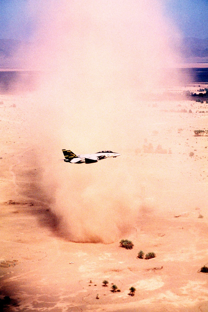 5. A United States Navy F-14A Tomcat Assigned to the 'Swordsmen' of Fighter Squadron Three Two (VF-32) Flies By a Very Big, Very Tall, Column-Shaped Desert Sandstorm, September 1, 1990, In the Vicinity of the Red Sea. Photo Credit: Lt. Cmdr. Dave Parsons, United States Navy (USN, http://www.navy.mil); Defense Visual Information Center (DVIC, http://www.DoDMedia.osd.mil, DNST9102741) and United States Navy (USN, http://www.navy.mil), United States Department of Defense (DoD, http://www.DefenseLink.mil or http://www.dod.gov), Government of the United States of America (USA).