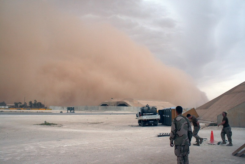 6. In Broad Daylight this Sandstorm, an Enormous Mountain of Sand and an Awesome Display of Nature's Wind Power, Approaches the Base and Engulfs the Hardened Aircraft Shelter, May 21, 2007, Al Asad, Al Anbar Province, Al Jumhuriyah al Iraqiyah - Republic of Iraq Photo Credit: Senior Chief Aviation Structural Mechanic Andrew Stack, United States Marine Corps (USMC, http://www.usmc.mil); Navy NewsStand - Eye on the Fleet Photo Gallery (http://www.news.navy.mil/view_photos.asp, 070521-N-0000X-021), United States Navy (USN, http://www.navy.mil), United States Department of Defense (DoD, http://www.DefenseLink.mil or http://www.dod.gov), Government of the United States of America (USA).