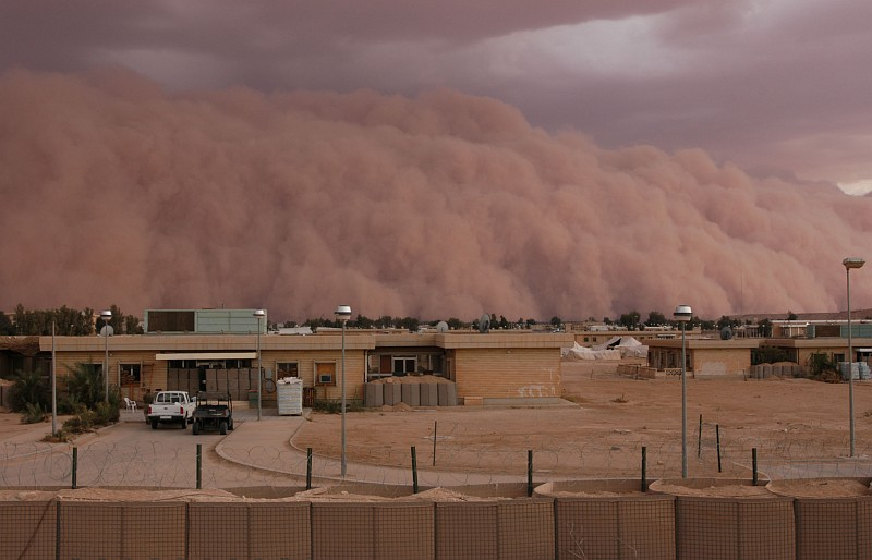 7. A Spectacular and Ominous View of an Approaching Sandstorm, an Unstoppable, Gigantic, Rolling Wall of Sand Between 4,000 and 5,000 Feet In Height, April 26, 2005, Al Asad, Al Anbar Province, Al Jumhuriyah al Iraqiyah - Republic of Iraq. Photo Credit: Gunnery Sgt. Shannon Arledge, 2nd Marine Aircraft Wing, USMC; Official Photo Archive - U.S. Marine Corps, Photo ID# :2005426141735 and 20050426-M-0502A-018, Marine Corps Photo Gallery (http://www.usmc.mil/marinelink/image1.nsf/imagearchive), United States Marine Corps (USMC, http://www.usmc.mil), United States Department of Defense (DoD, http://www.DefenseLink.mil or http://www.dod.gov), Government of the United States of America (USA). See the Marine Corps News story 'Dust in the wind: A wall of sand moves through Al Asad' by USMC Gunnery Sgt. Shannon Arledge, 2nd Marine Aircraft Wing, April 26, 2005 (Story ID#: 2005426134811, http://www.usmc.mil/marinelink/mcn2000.nsf/lookupstoryref/2005426134811).