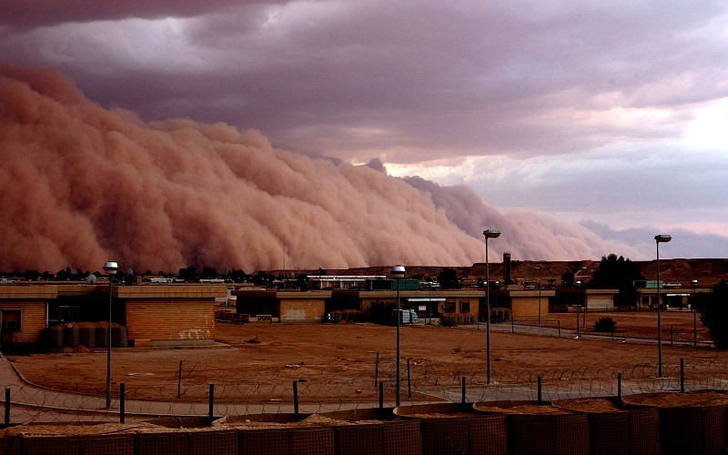 9. The Long, Huge, Rolling Mountain of Sand is a Sandstorm 4,000 to 5,000 Feet High, and It Appears to Touch the Clouds In the Sky Above, April 26, 2005, Al Asad, Al Anbar Province, Al Jumhuriyah al Iraqiyah - Republic of Iraq. Photo Credit: Gunnery Sgt. Shannon Arledge, 2nd Marine Aircraft Wing, United States Marine Corps (USMC, http://www.usmc.mil); 'DefendAmerica - U.S. Defense Dept. War on Terror: 04/26/2005 - Edition 7, STORMY WEATHER' (http://www.DefendAmerica.mil/archive/2005-04/20050426pm4.html, http://www.DefendAmerica.mil), Photo ID: 20050426-M-0502A-017, United States Department of Defense (DoD, http://www.DefenseLink.mil or http://www.dod.gov), Government of the United States of America (USA). See the Marine Corps News story 'Dust in the wind: A wall of sand moves through Al Asad' by USMC Gunnery Sgt. Shannon Arledge, 2nd Marine Aircraft Wing, April 26, 2005 (Story ID#: 2005426134811, http://www.usmc.mil/marinelink/mcn2000.nsf/lookupstoryref/2005426134811).