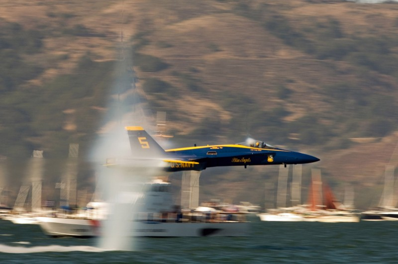 9. A U.S. Navy Blue Angels F/A-18 Hornet Fighter Jet Flying Low Over the Water at Speeds Just Below Mach 1 -- a Sneak Pass Maneuver Performed By the Lead Solo, October 9, 2005, San Francisco, State of California, USA. Photo Credit: Photographer's Mate 2nd Class Ryan Courtade, Navy NewsStand - Eye on the Fleet Photo Gallery (http://www.news.navy.mil/view_photos.asp, 051009-N-7559C-001), United States Navy (USN, http://www.navy.mil), United States Department of Defense (DoD, http://www.DefenseLink.mil or http://www.dod.gov), Government of the United States of America (USA).