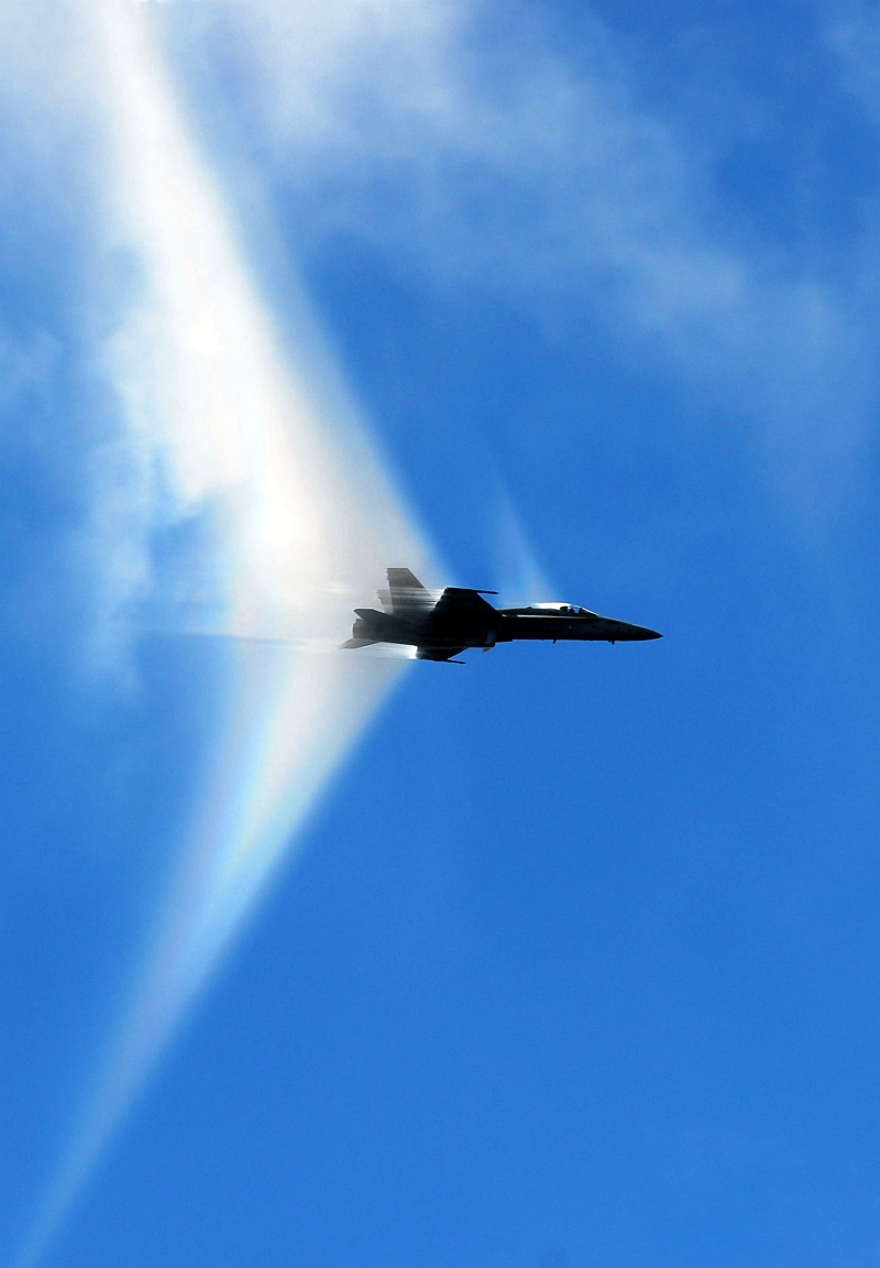 15. A Transonic U.S. Navy F/A-18C Hornet Fighter Jet Assigned to the 'Argonauts' of Fighter Squadron 147 (VFA-147) Executes A High-Speed Flyby Near the U.S. Navy Aircraft Carrier USS John C. Stennis (CVN 74), August 24, 2007, Pacific Ocean. Photo Credit: Mass Communication Specialist 2nd Class Ron Reeves, Photo Gallery (http://www.navy.mil/viewGallery.asp, 070824-N-0684R-060), United States Navy (USN, http://www.navy.mil), United States Department of Defense (DoD, http://www.DefenseLink.mil or http://www.dod.gov), Government of the United States of America (USA).