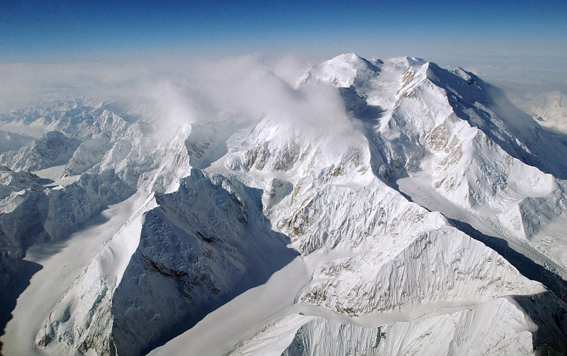 Spectacular Aerial View of a Great Mountain Range -- Snow-Covered Mountain Peaks In the Alaska Range, Including Mt. McKinley (Mt. Denali), the Highest Mountain and Highest Point on the North American Continent, April 21, 2002, State of Alaska, USA. Photo Credit: Senior Airman D. Myles Cullen, 1st Combat Camera, United States Air Force; Defense Visual Information Center (DVIC, http://www.DoDMedia.osd.mil, DFSD0405085 and 020421F0193C001) and United States Air Force (USAF, http://www.af.mil), United States Department of Defense (DoD, http://www.DefenseLink.mil or http://www.dod.gov), Government of the United States of America (USA).